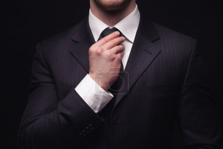 Closeup of young businessman suit