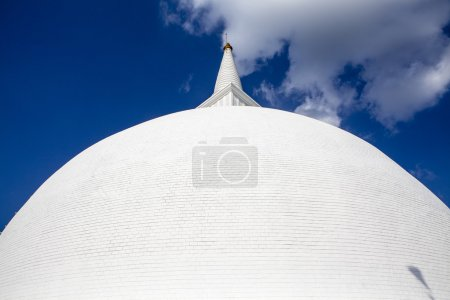 A big white stupa / pagoda surrounded by pillars, in Mihintale, Sri Lanka - Asia