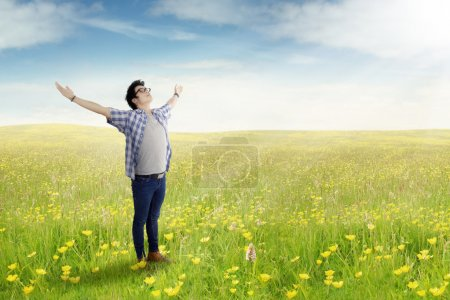 Young man standing on the meadow