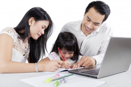 Asian parents teach their child to write