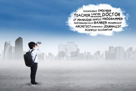 Schoolboy looking at his dream job