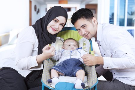 Muslim family and their son in stroller