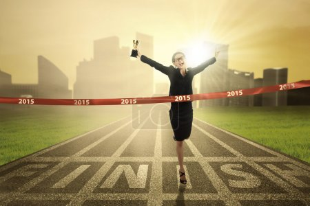 Businesswoman get a trophy in competition