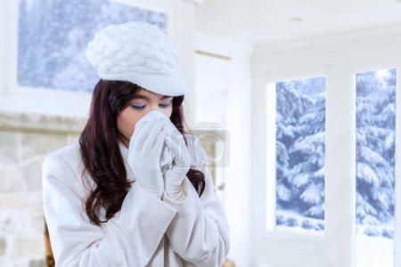 Woman using handkerchief for sneezing