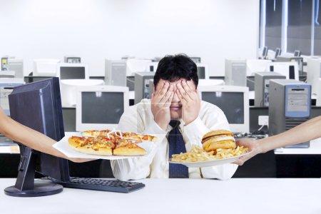 Businessman avoid junk food