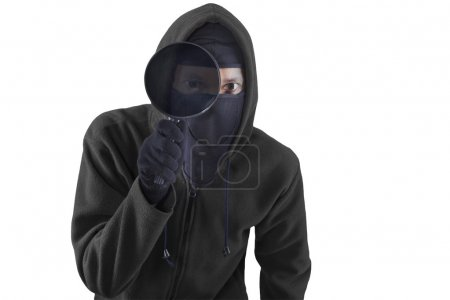 Person wearing a mask and use magnifying glass for...
