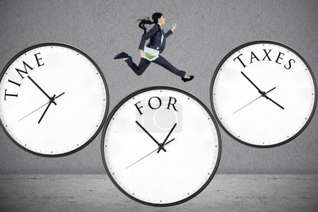 Concept of time for taxes with a businesswoman run...