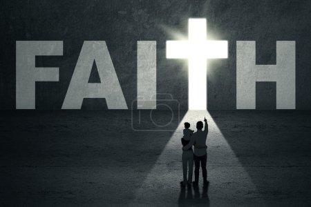 Photo pour Portrait of family standing in front of faith door with cross symbol - image libre de droit
