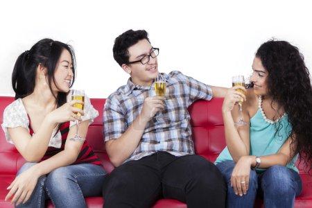 Mixed race teenagers drinking beer