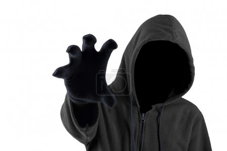 Male robber wearing gloves and hoodie, showing his...