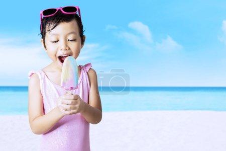 Child enjoy ice cream at seaside