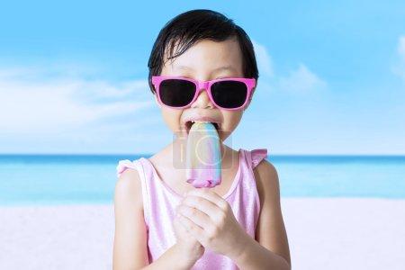Cute female kid enjoy ice cream