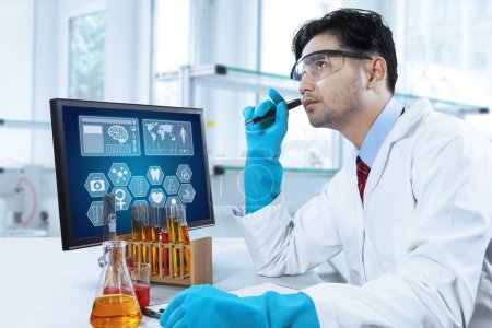 Photo for Portrait of male scientist thinking an idea to find a discovery while working in the laboratory - Royalty Free Image