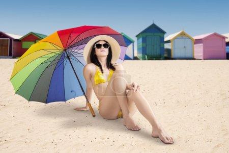 Pretty woman sitting at Brighton beach