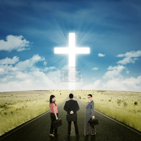 Entrepreneurs on the road with a cross