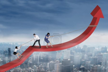 Group of entrepreneurs raise financial graph