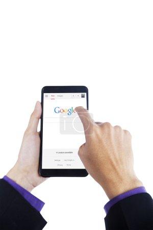 Hand touching google logo on