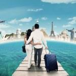 Постер, плакат: Couple going to honeymoon on the famous monuments