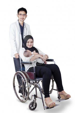 Arabian doctor with patient and her baby