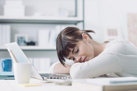 woman at office desk sleeping