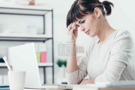 tired woman having a bad headache