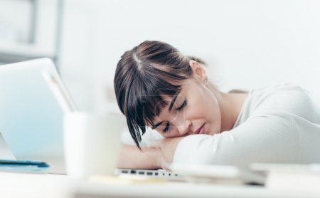 Young tired woman sleeping