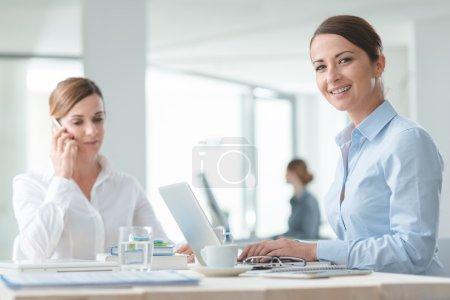 Confident business women working