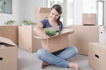 Beautiful woman unpacking