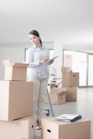 Businesswoman moving in her new office