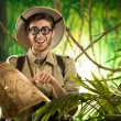 Постер, плакат: Explorer finding the right path in the jungle