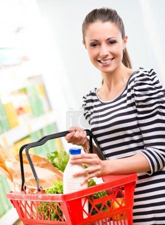Smiling woman with shopping basket