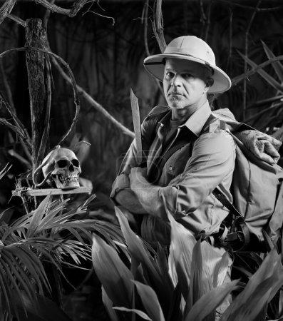 Adventurer in jungle with skull