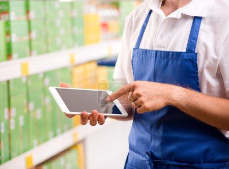 Sales clerk using tablet