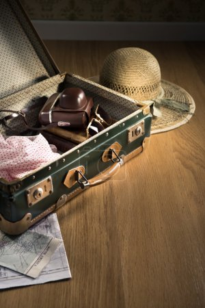 Vintage luggage with sunglasses
