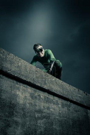 Superhero on all fours escaping danger