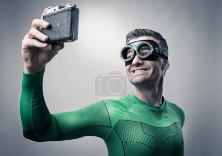 Superhero taking a selfie