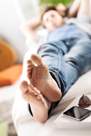 Man Relaxing barefoot