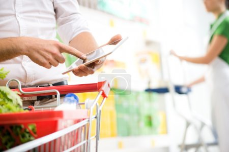 Customer using  tablet at supermarket