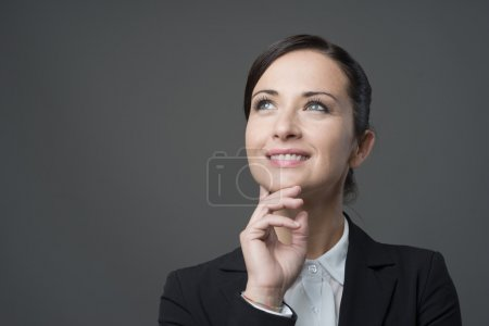 Business woman with hand on chin