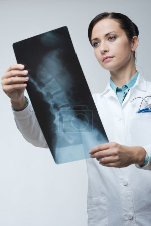 Female doctor examining x-ray