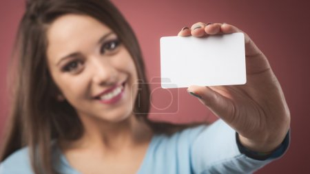Woman holding a blank business card