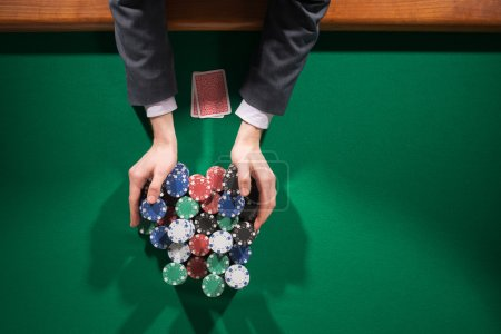 Poker player betting all in