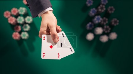 Poker player holding two aces