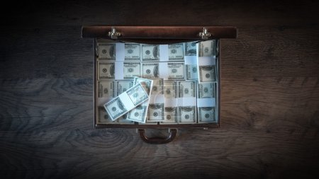 Briefcase filled with dollar packs
