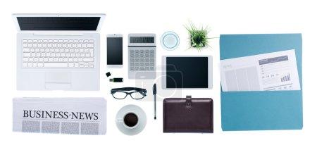 Photo pour Bureau d'affaires Hi-tech avec ordinateur, smartphone, paperasse et nouvelles d'entreprise, vue de dessus sur fond blanc - image libre de droit