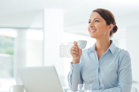 Business woman having a coffee break