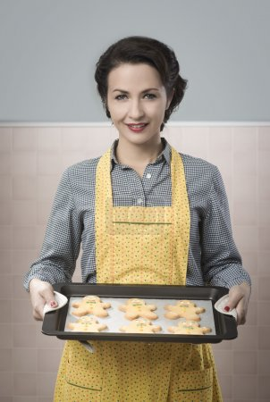 Photo for Beautiful smiling woman cooking gingerbread - Royalty Free Image