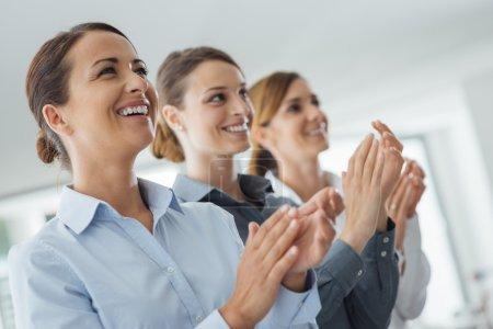 business women applauding