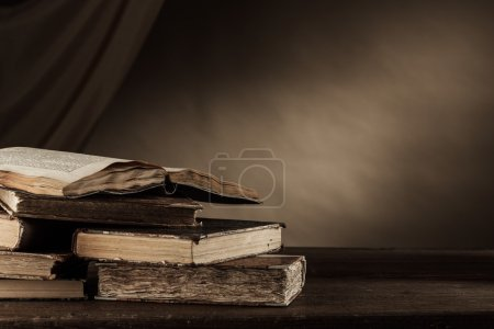 Ancient books on a wooden table