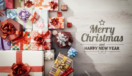 Photo for Lots of colorful gifts on a wooden table top view, celebration and Christmas concept - Royalty Free Image
